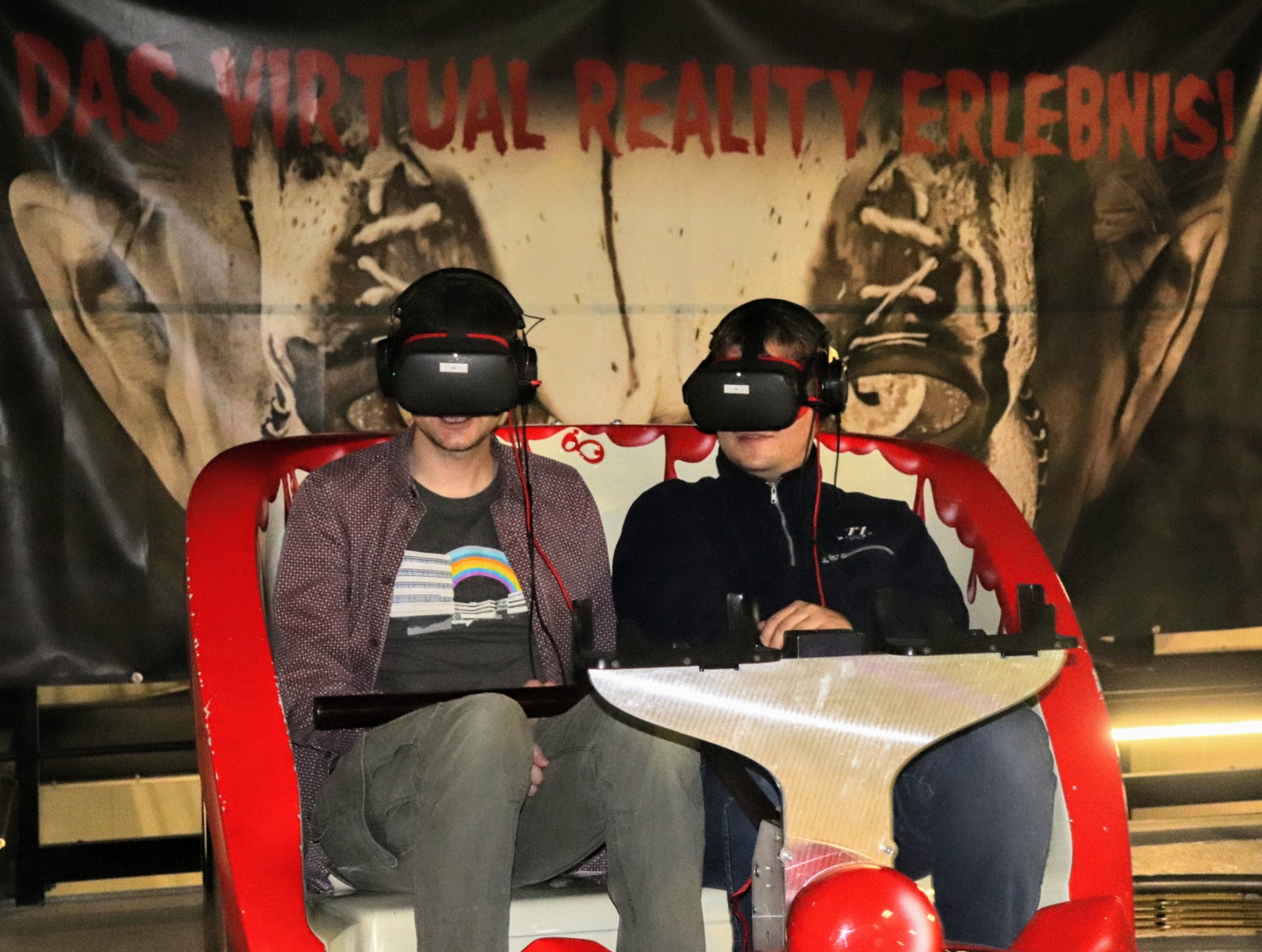 fun ride car with two people in it wearing VR headsets